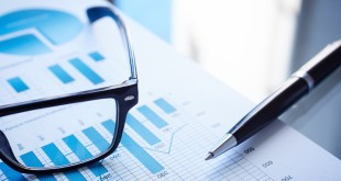 Image of eyeglasses, pen and financial document